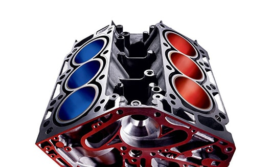 V-6 cylinder block with red cylinders on one bank, blue on the other.