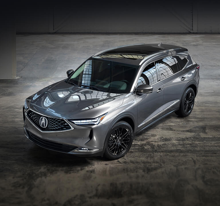 2022 Acura MDX Advance in Liquid Carbon Metallic in a warehouse